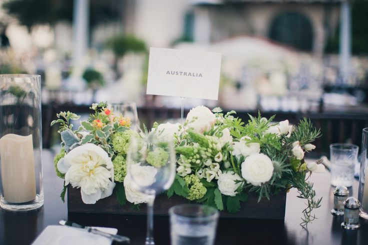 Acknowledge guests who have travelled from afar. Country tags for centerpiece arrangements.