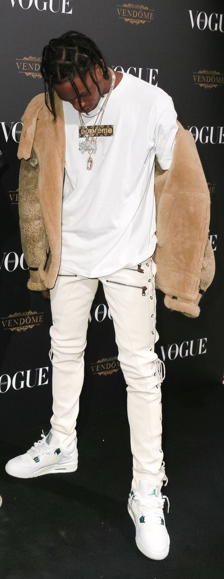 Loving this outfit from Travis with the LV Supreme tee, fur jacket and and white J's on white denim...clean