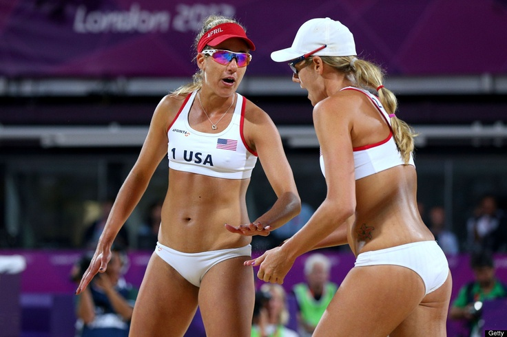 Jennifer Kessy and April Ross of the United States celebrate a point during the Women's Beach Volleyball Gold medal match on Day 12 of the London 2012 Olympic Games at the Horse Guard's Parade on August 8, 2012 in London, England.