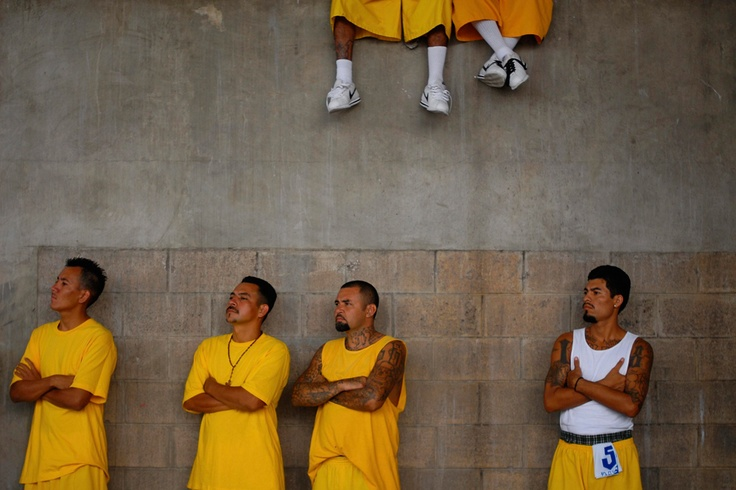 Members of the 18th Street gang attend a mass at the prison of Izalco in El Salvador on April 13, 2012. (Ulises Rodriguez/Reuters) #