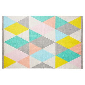 Decadent and on-trend, add some bright texture to your hardfloors with this gorgeous Kaleidoscope Triangle Floor Rug. Perfect for under tables, seating...