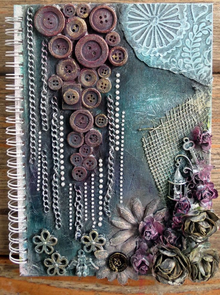 Mixed Media, journal cover. textured background with gesso, tissue paper, foil and embossed aluminium sheet.  Dry brushed over with acrylic paint