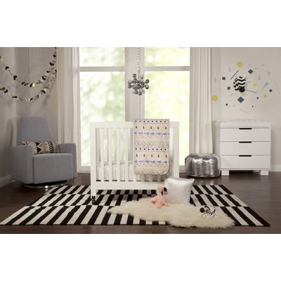 Cute gender neutral nursery with whites, greys... love this!  The glider is available on Wayfair for $500.