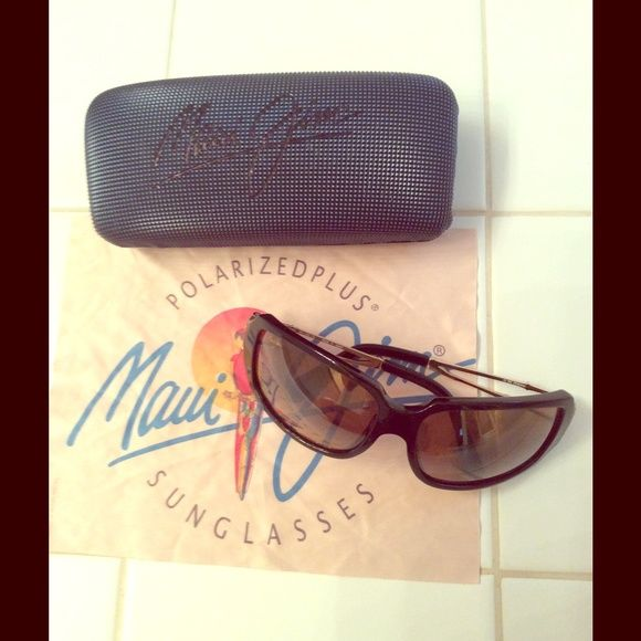 Authentic Maui Jim Polarized Sunglasses Woman's polarize sunglasses.  Like new, no scratches..  Case included. Roughly 6 inches measured side to side, refer to pic. Maui Jim Accessories Sunglasses