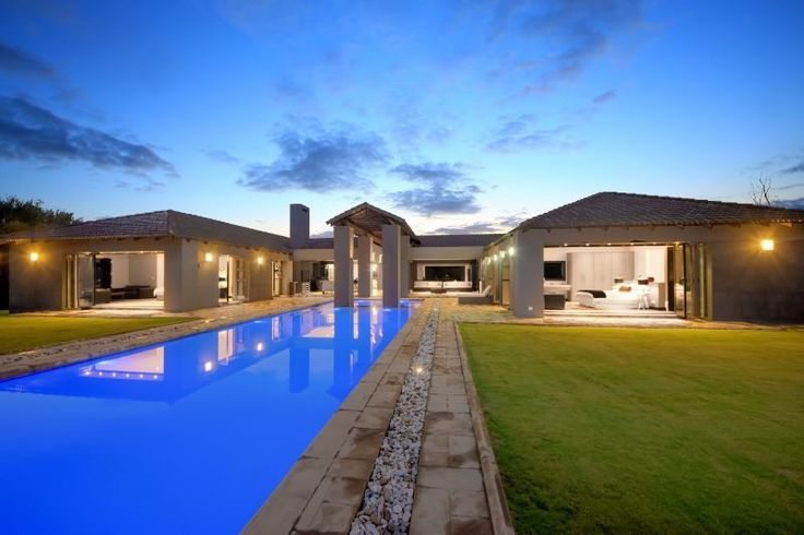 This absolutely magnificent ultra-modern home in Blair  Atholl Golf Estate will suit the most sophisticated buyer. With every reception door opening up completely to the stunning undercover patio, bar, pool and enormous garden, with river-frontage, this home has it all for the best entertaining ever. There are four bedroom en suites. Cocktails all round!