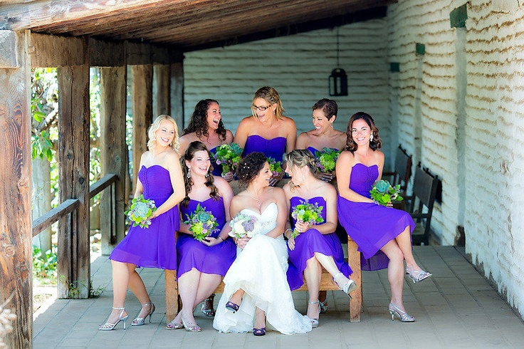 Bright purple bridesmaid dresses with green flowers