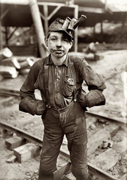 Lewis Wickes Hine, A young mine worker: Turkey Knob Coal Mine, Macdonald, West Virginia, 1908  SIDE NOTE: I study this photo with my students and they always ask what it is on his head.  When I tell them it's an oil lamp to see in the mines while he works, they get very quiet.  He looks so young.