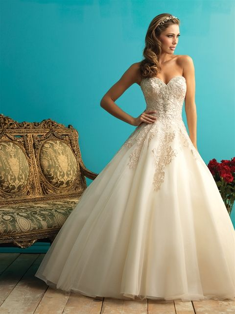 STYLE: 9270  This ballgown features an embroidered bodice, highlighted by Swarovski crystals at the neckline.  Colors: White/Silver, Ivory/Silver, Gold/Champagne/Silver Fabric: Lace and English Net Size: 2 - 32