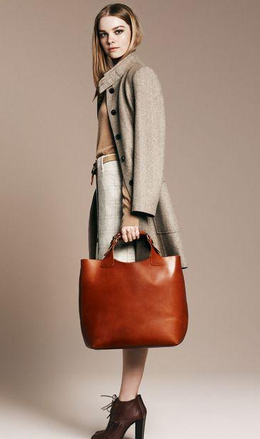 \\ griege linen skirt, flesh-tone cashmere sweater, oatmeal tweel overcoat, cognac tote & dark brown heeled lace-up booties