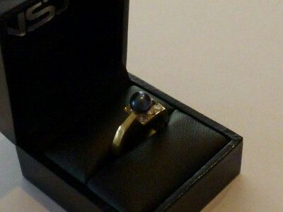 18ct black pearl and diamond ring