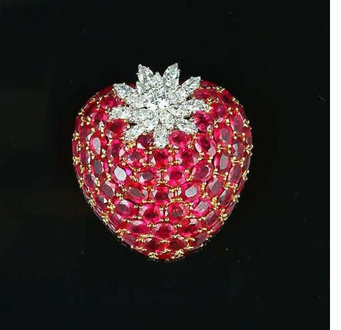 A ruby and diamond strawberry brooch, set with oval-shaped rubies and marquise and brilliant-cut diamonds. Bonhams (=)