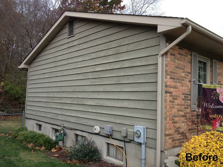 Before picture of the side of the house with old Masonite Siding