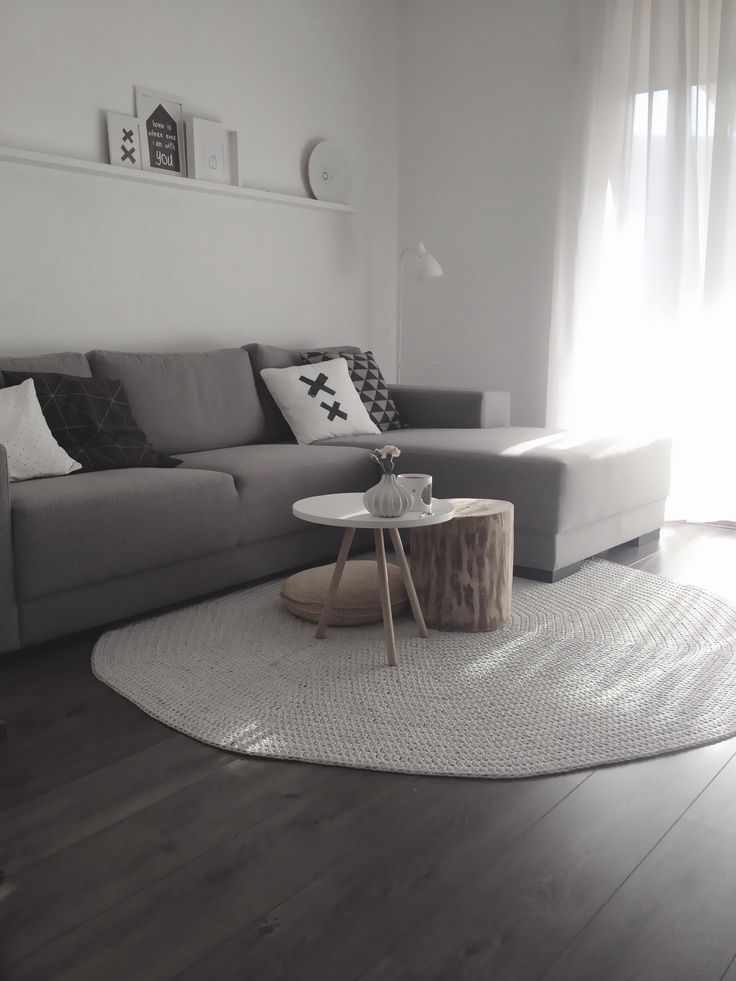 Grey lounge room. I like the coffee table teamed with the wooden stool and big floor pillow