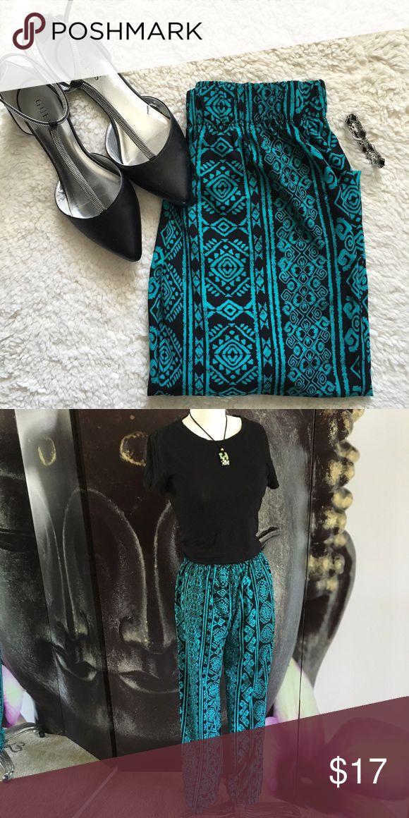 "Bohemian Tribal Print Pants Beautiful bohemian tribal print pants. NWOT. 39"" in length. Laying flat waist: 13""-19"" due to elastic waist. 100% Polyester. Elastic leg cuffs. Ambiance Apparel Pants"