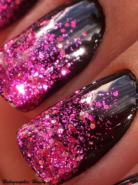 Pink glitter over black polish...  1) Apply a glossy black polish and let dry  2)Apply a pink glitter polish to a makeup sponge and dab on the very tips of nails until you have a solid pink tip  3)Create a gradient using less and less glitter towards the nail bed.  4) Voila!  Glitter Gradient Nails! [cuticle area is sloppy, but cute overall]