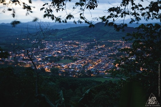 Many towns in Colombia are right in the middle of the mountains and the coffee crops.