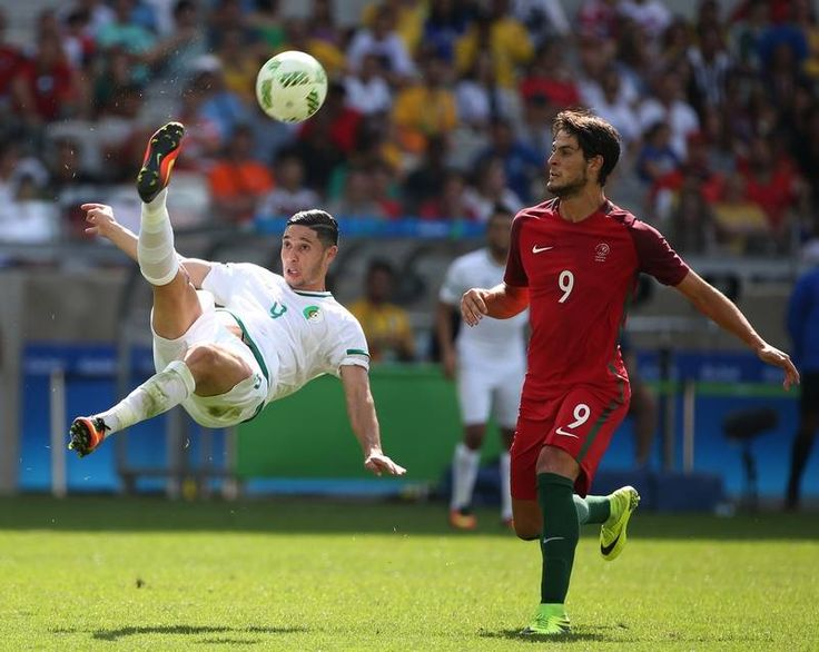 Algeria's Mohammed Benkablia, left, does a bicycle kick as Portugal's Paciencia looks on during a group D match of the men's Olympic football tournament between Argelia and Portugal at the Mineirao Stadium in Belo Horizonte, Brazil, Wednesday, Aug. 10, 2016. the game ended in a 1-1 draw.