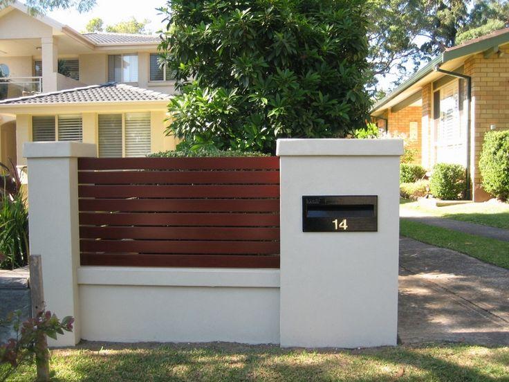 Letterbox built into brick fence Designs Spaces