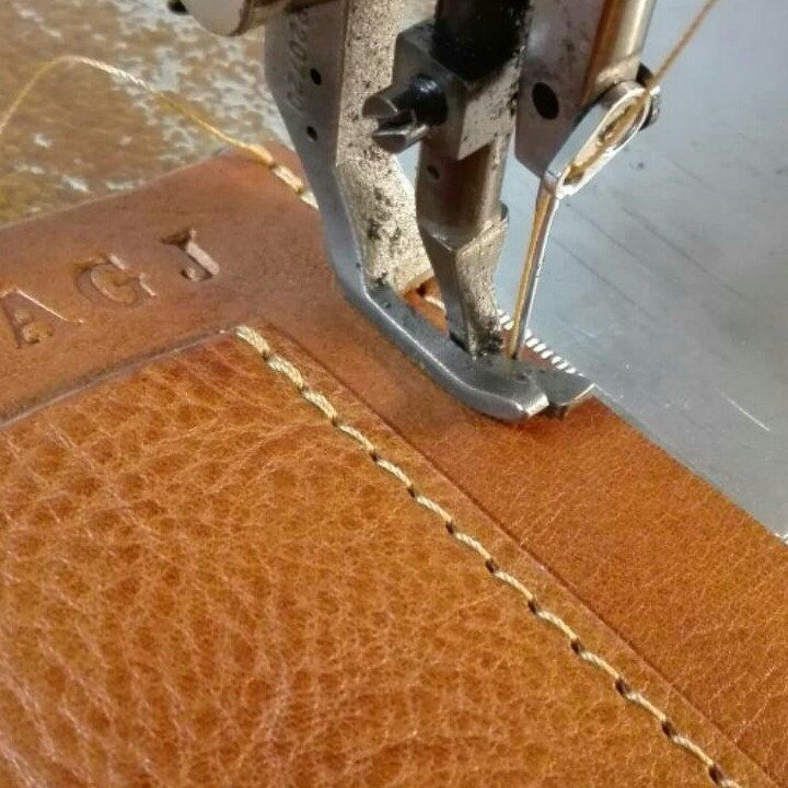 Personalization on Greg`s briefcase!!! Artisan at work...