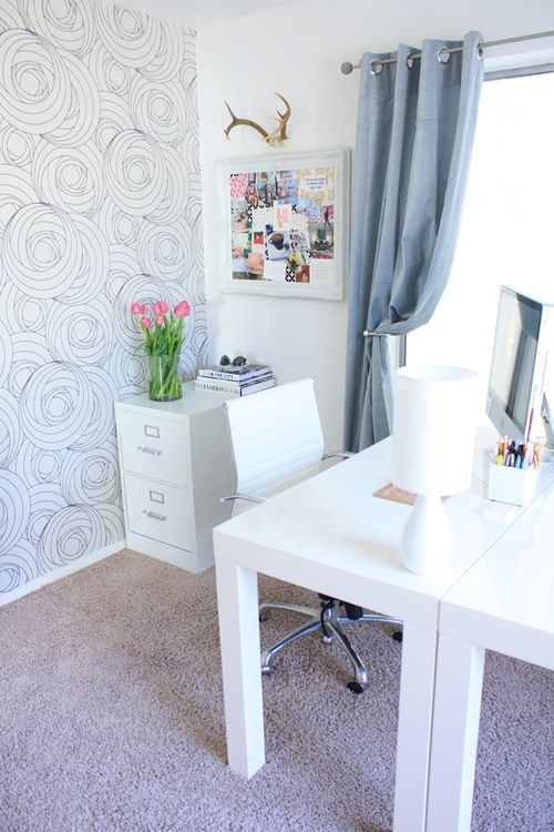 love this home office...the wallpaper? the antlers? the brightness? the curtains? yes.