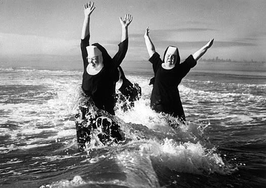 Happy nuns feeling joyful and free.
