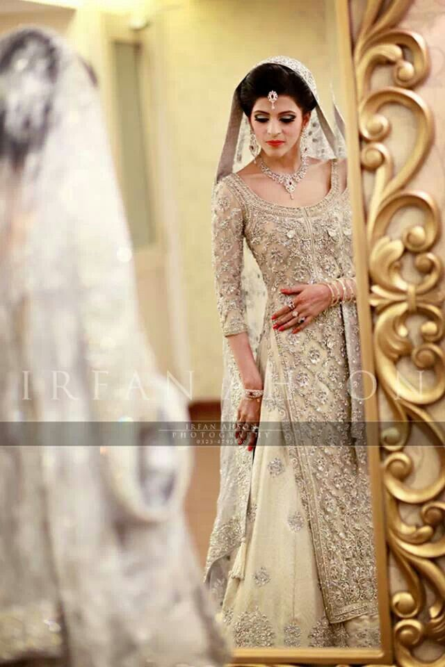 Mirror mirror on the wall, who's the fairest of them all? Definitely this Pakistani Bride, her dress is simply stunning - the color, the work, her jewelry, makeup, hair, everything ties together so perfectly! | Irfan Ahson Photography