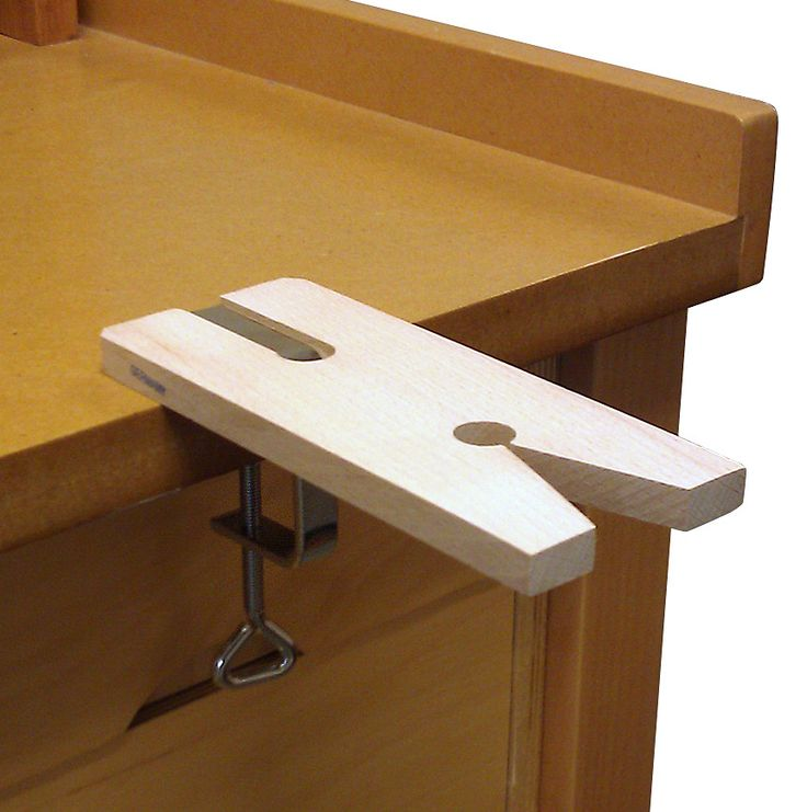 Indispensable to any workbench for sawing and working on various materials. Ours is quality hardwood with a deluxe clamp made in Germany. Clamps easily onto bench edge up to 1-3/4 thick.