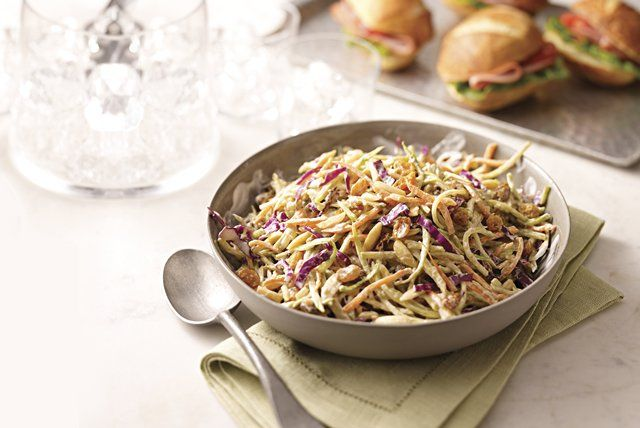 You are not predictable, so why should your potluck dish be? Mix it up a little with the Asian flavors of sesame dressing and slivered almonds in a creamy broccoli slaw.