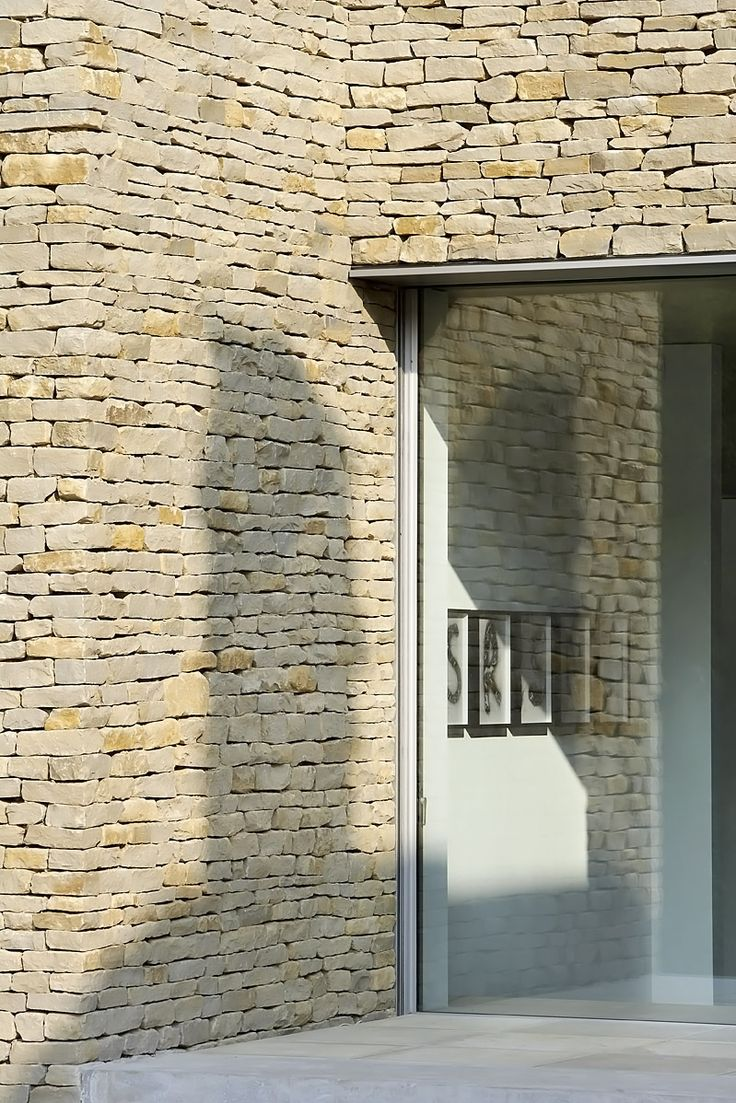 I like the drystone effect next to the modern crisp internal walls  Hufton + Crow | Projects | Private House