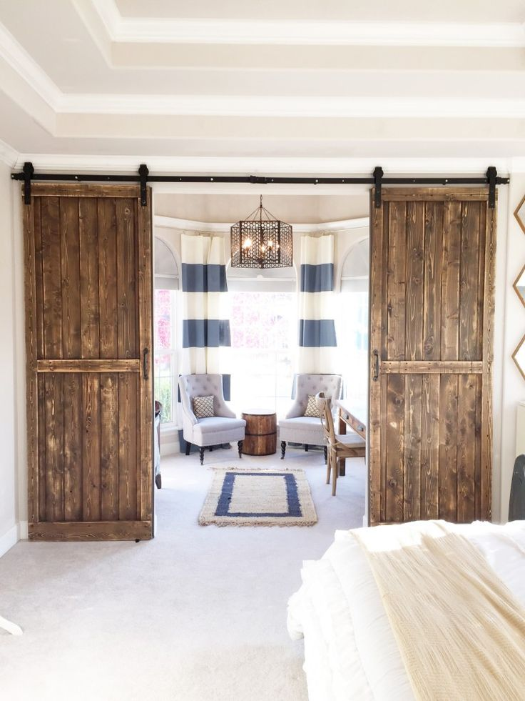 If you have extra space in a room, consider adding a set of barn doors and turning the area into a useful nook like an office or nursery.