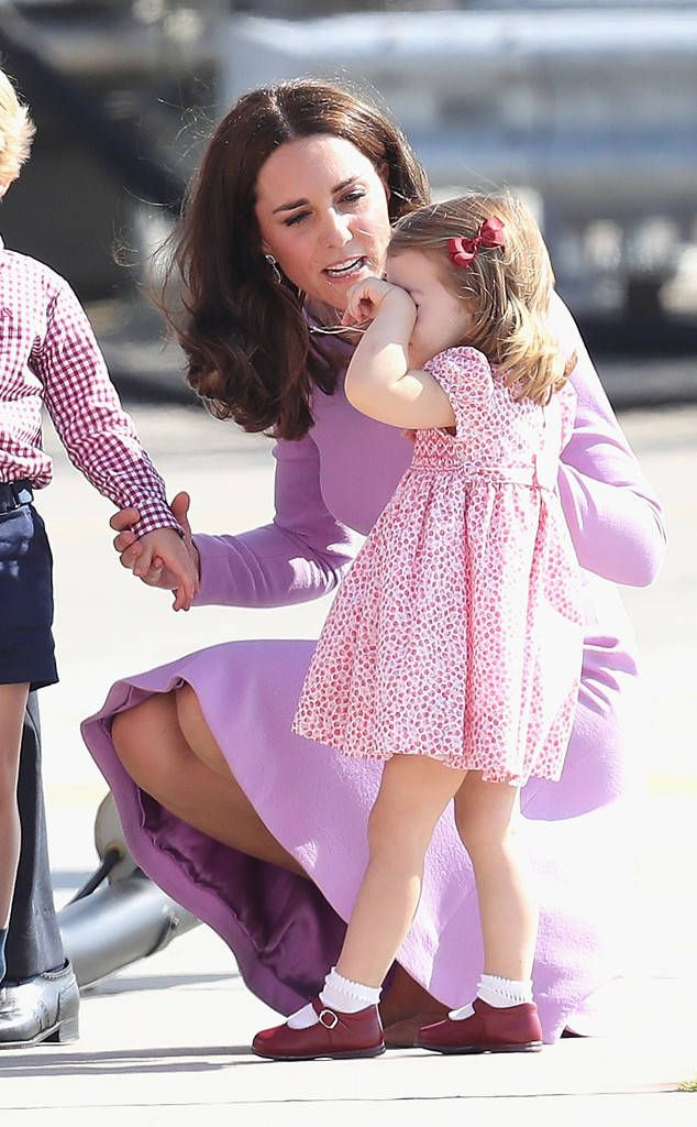 Tired Princess from Prince William and Kate Middleton's Royal Tour of Poland and Germany  The Duchess of Cambridge comforts her tired daughter Princess Charlotte beforedeparting from Hamburg airport in Germany.