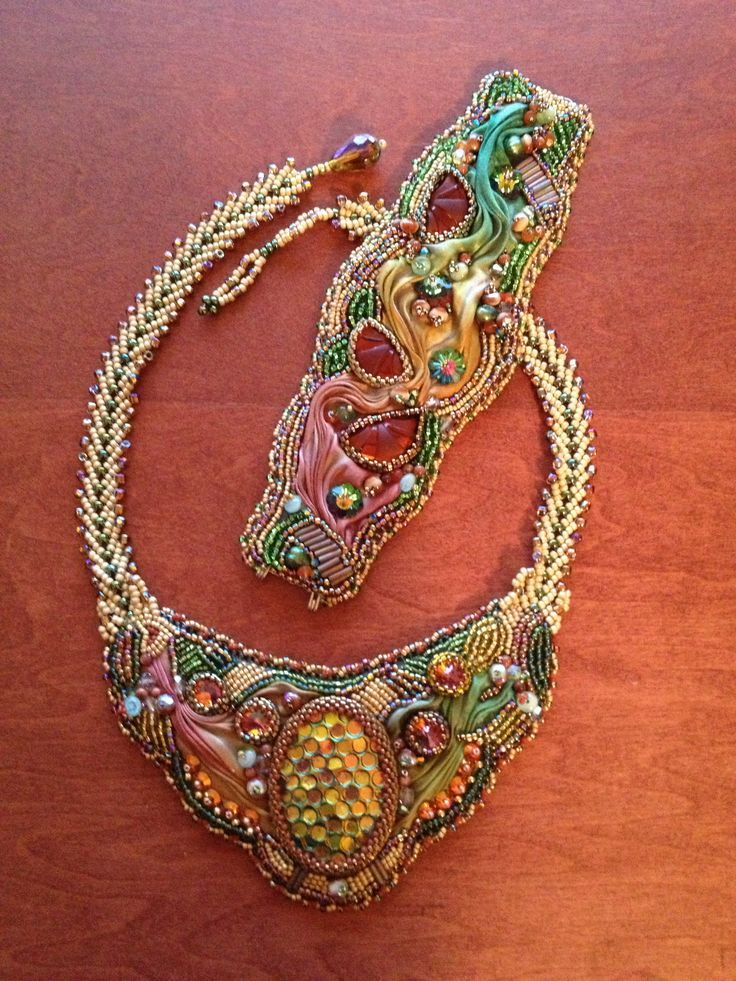 Necklace and bracelet using seed beads, Swarovski crystals, glass art beads, Shibori silk ribbon and leather backing.  Bead embroidery and St. Petersburg chain.