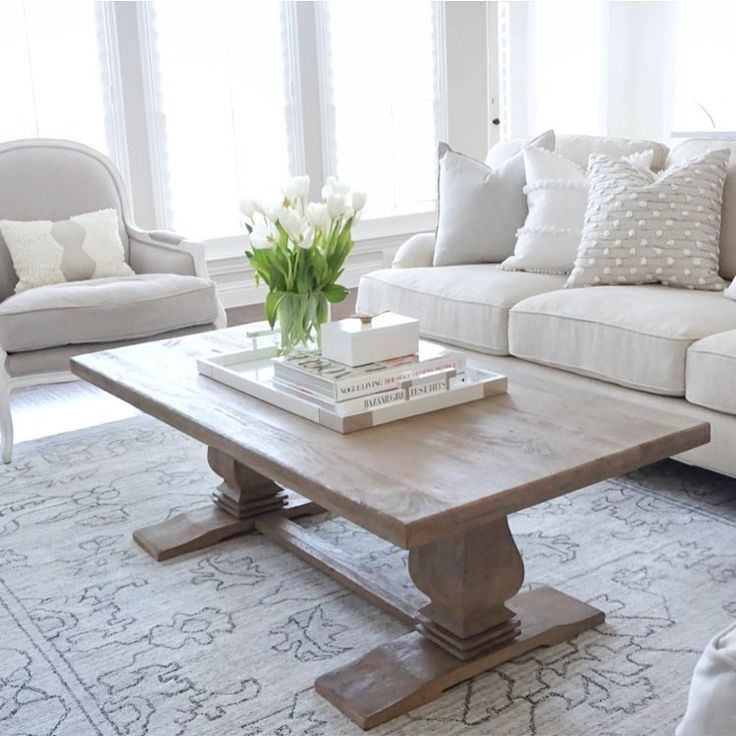 Living room inspo Restoration Hardware Lyon Chair NFM English roll arm sofa home decorators coffee table target pillows Nate Berkus white tulips vogue living book neutral decor See this Instagram photo by @thedecordiet •