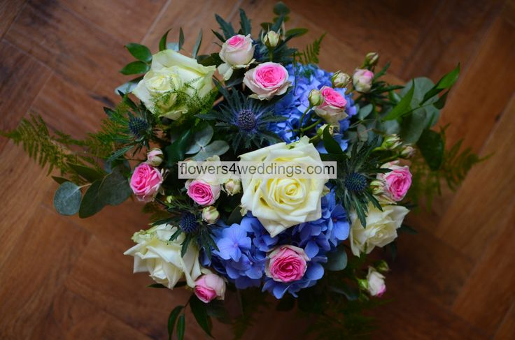 Ivory, blue and pink wedding table arrangement