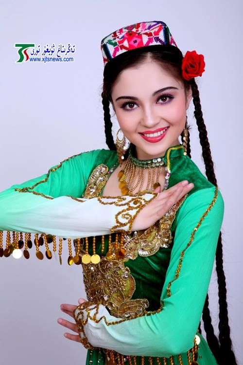 Uyghur girl in traditional dress.