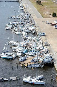 Hurricane Ivan sank and stacked numerous boats at Bayou Grande Marina at NAS Pensacola. #hurricaneivan, #CabinetHardware.org, #hurricane