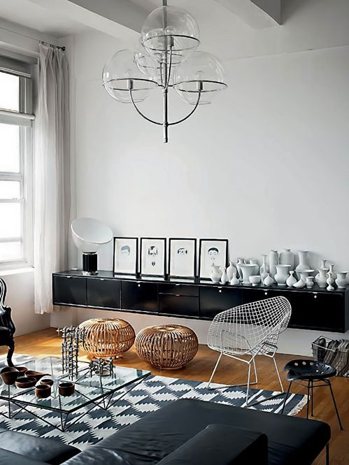 The black and white plus wood and rattan nevers fails to give an arty, contemporary look especially when a funky 3-ball chandelier is the lighting centrepiece.