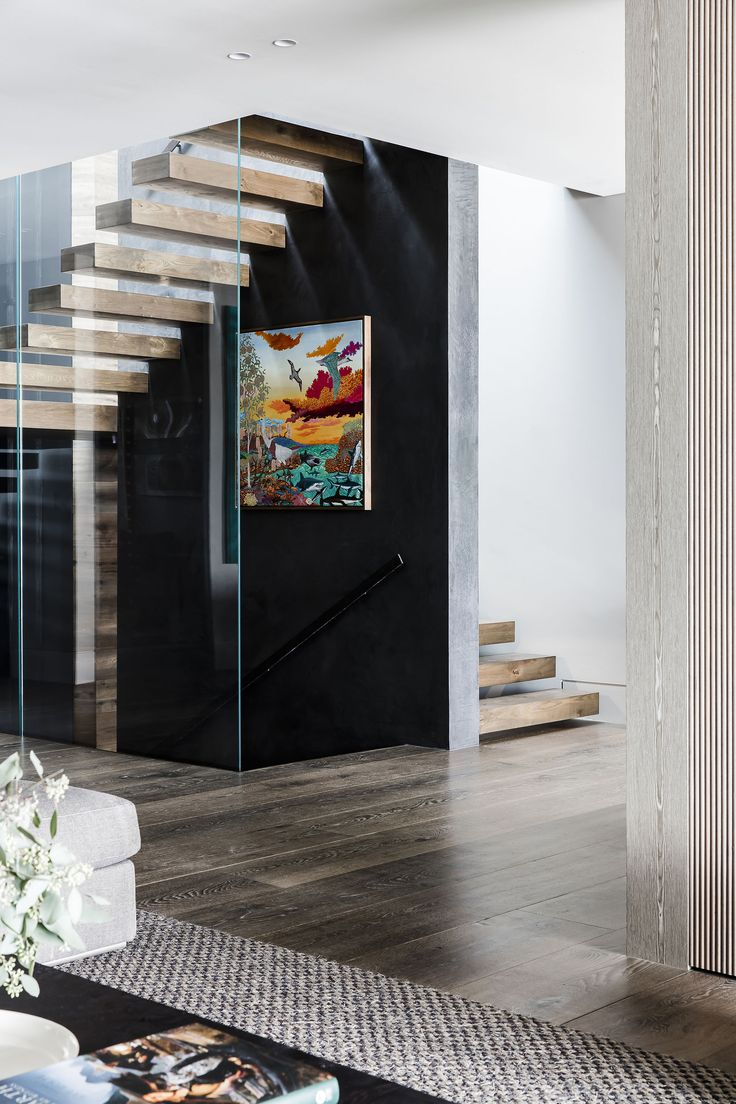 Two skylights filter light through the foyer, staircase and glass wall in this contemporary home on Sydney's northern beaches. Photography: Maree Homer | Styling: Kayla Gex | Story: Australian House & Garden   L