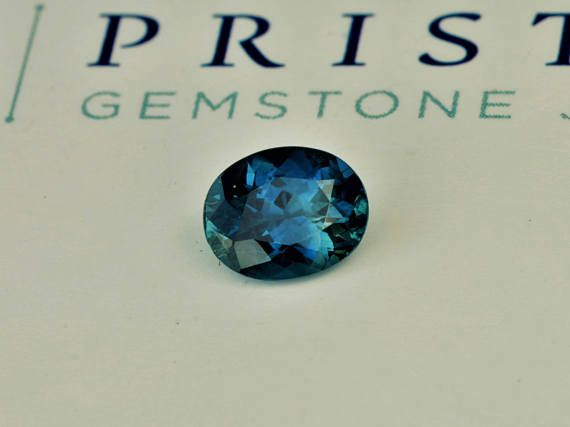 Oval blue green sapphire September gemstone for jewellery. One of a kind color sapphire. size: 7.5 x 6 mm oval weight: 1.44 cts color: blue with green as secondary color clarity: eye clean origin: Australia Precision cut by Rogerio. Only 5% of gemstones currently on the market are
