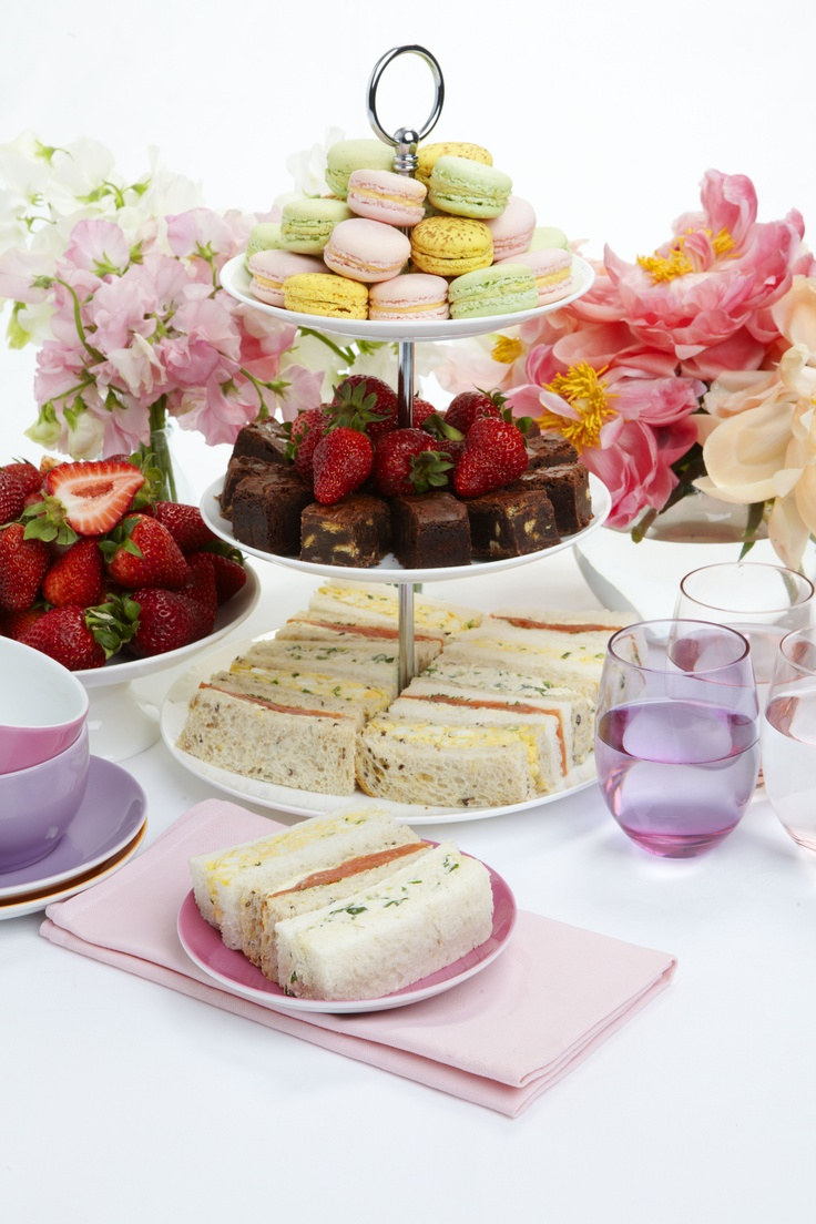 Macarons (NOT Macroons, they are two different things) & tea sandwiches. Probably cucumber and salmon because those are the most common tea sandwiches, and that's what they look like!