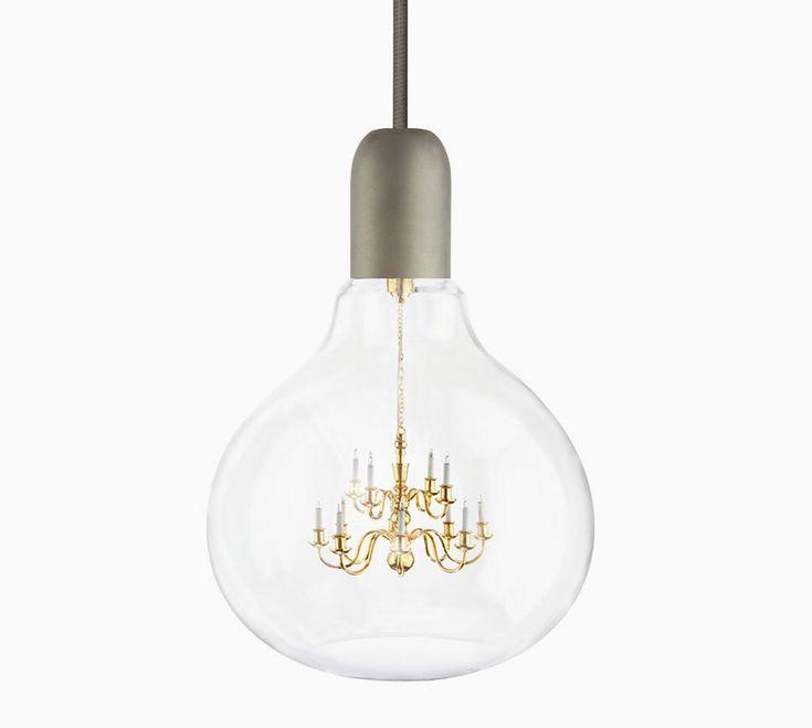 young & battaglia suspends a chandelier inside a lightbulb for mineheart