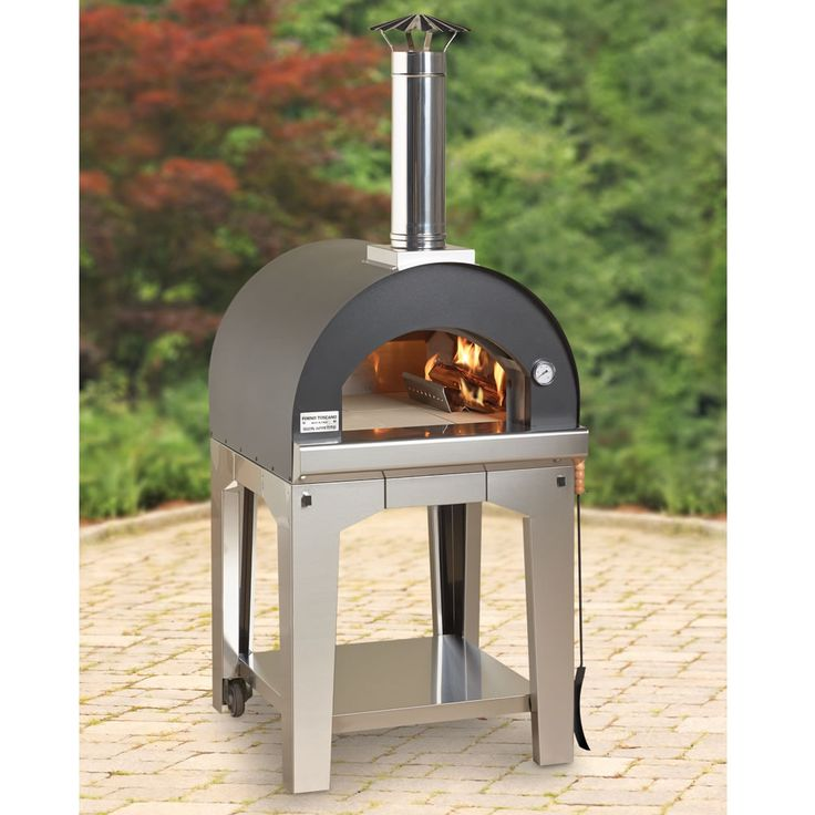 The Rapid Heating Wood Burning Pizza Oven - Handcrafted in Marche, Italy, this is the outdoor wood-burning oven that's ready to cook in 15 minutes. Unlike typical wood burning ovens that require hours of preheating, this superior oven's entire cooking chamber is insulated with basalt, a dense, volcanic rock that retains 10X more heat than the clay or brick used in traditional ovens. - Hammacher Schlemmer