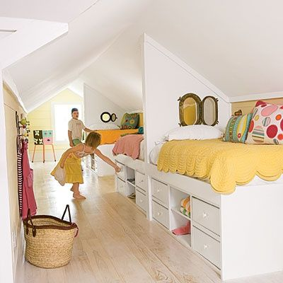 Create a bunk room in an otherwise unusable attic space. Back-to-back beds fit just right in this long, narrow room. Built-in storage maximizes limited square footage. The under-the-bed drawers are easy for kids to reach and eliminate the need for bulky dressers.