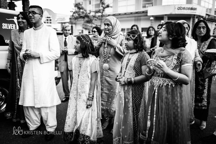 Pakistani wedding. Watching the groom enter (Kristen Borelli Photography, Pakistani Wedding, Vancouver Island Wedding Photography, Victoria Wedding Photography, Nanaimo Wedding Photography, Prince George Wedding Photography)