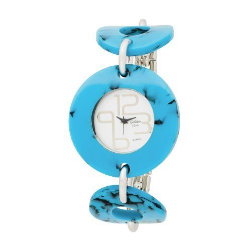 """Golden Classic Women's 3161_Turq """"Fashionista"""" Turquoise Circles Accessory Watch Golden Classic. $28.99. Highest standard Japanese quartz movement. Silver sunray dial with silver 12-3 and 6-9 joined designer numerals and hands. Water-resistant to 99 feet (30 M). Round turquoise plastic case. Turquoise rings held by silver metal links. Save 43%!"""