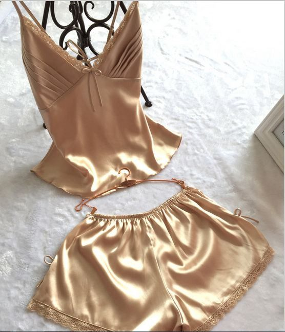 Gender: Women Item Type: Pajamas Pattern Type: Solid Brand Name: lisacmvpnel Material: Rayon Length: Shorts Season: Summer Collar: V-Neck Sleeve Length: Sleeveless Material Composition: rayon silk Mod