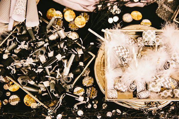 Blowouts, party horns, and the like — place them up for grabs on a table so guests can get carried away when the ball drops. Bonus: They double as favors to take home and can make a great décor statement.