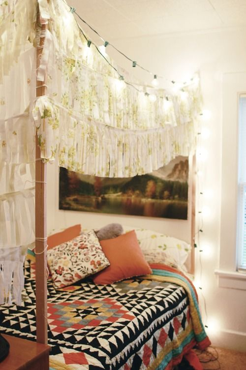 #garlands of fringe + my dream UrbanOutfitters quilt + strings of lights