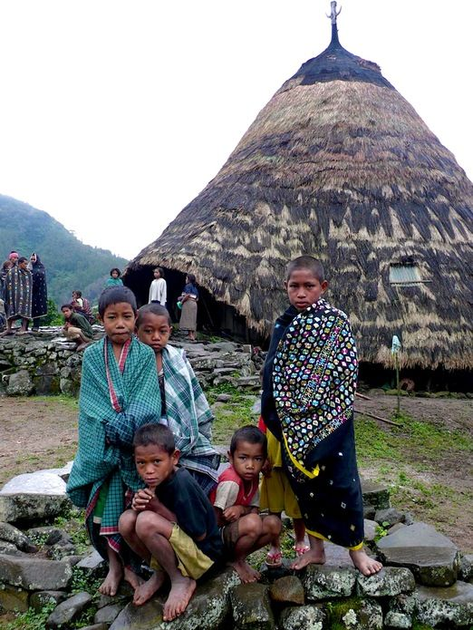 Kids in Wae Rebo village: Now you can visit the village, stay with the locals in their authentic mbaru niang and experie...