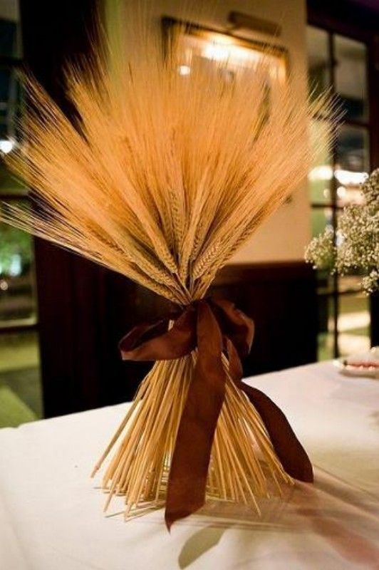 have you thought about doing something non-floral as centerpieces? These wheat centerpieces are elegant and striking.